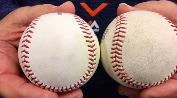 Houston pitching coach Brent Strom holds a 2017 regular season baseball (left) and a 2017 World Series ball.