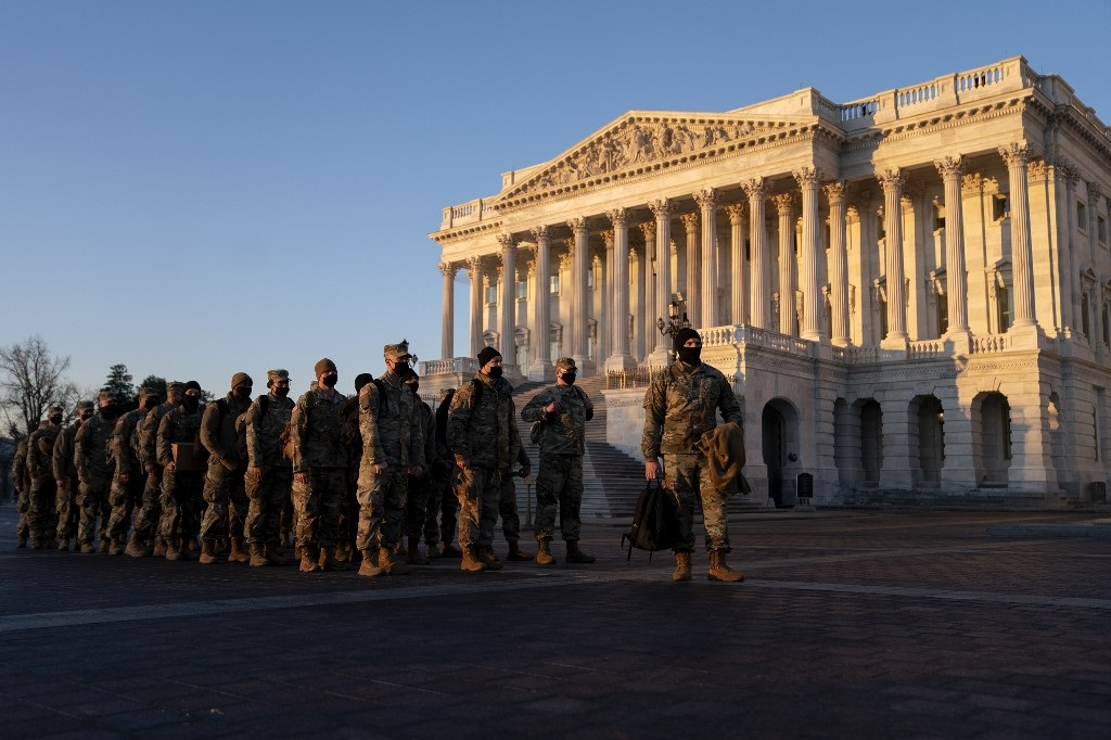 Members of the National Guard gather outside the US Capitol. (Stefani Reynolds, Getty Images via AFP)