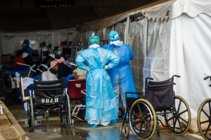 Health care workers and patients in temporary area
