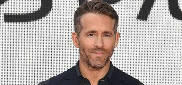 This shirtless picture of Ryan Reynolds made us so thirsty - can someone please pass the water?