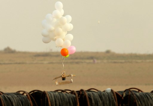 Balloons carrying an alleged incendiary device