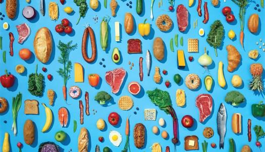 Various healthy foods in pattern on blue