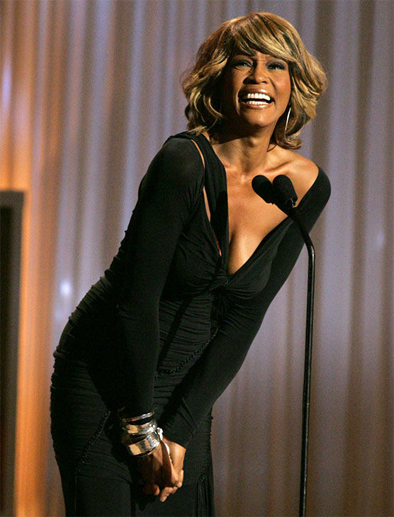 Oct. 2005: Houston smiles as she recevies a standing ovation while coming onto the stage at the Shrine Auditorium. <span class=meta>Photo/AP Photo</span>