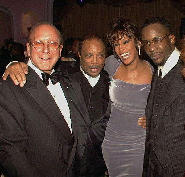 Feb 1996: Arista Records head Clive Davis, left, at his 10th annual pre-Grammy party with, from left, Quincy Jones, Whitney Houston, and Bobby Brown. <span class=meta>Photo/AP Photo</span>