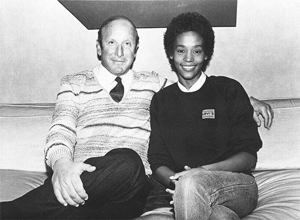 1983: Houston with music producer Clive Davis shortly after signing a contract with Arista Records. <span class=meta>Photo/AP Photo</span>