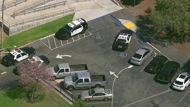 Law enforcement vehicles are parked outside Walnut High School on Thursday, March 24, 2016.