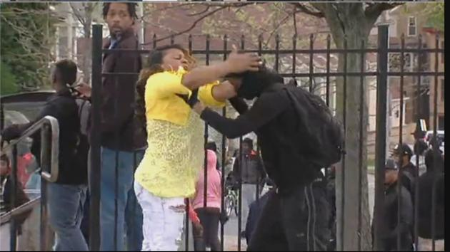 VIDEO: Angry mom beats son suspected of rioting in Baltimore on live TV