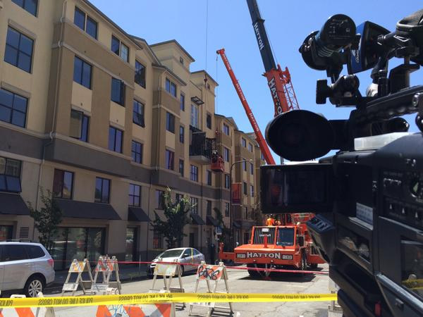 <div class='meta'><div class='origin-logo' data-origin='none'></div><span class='caption-text' data-credit='KGO-TV/Dean Smith'>Roads were blocked off after a balcony collapsed in Berkeley, Calif. on Tuesday, June 16, 2015.</span></div>