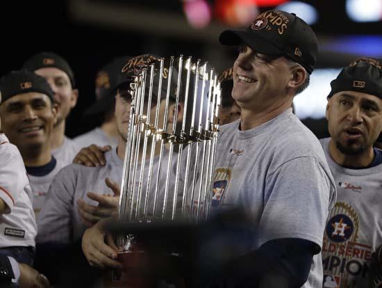 "<div class='meta'></img><div class='origin-logo' data-origin='AP'></div><span class='caption-text' data-credit='AP'>Houston Astros manager A.J. Hinch holds the championship trophy after Game 7 of baseball's World Series. (AP Photo/Matt Slocum)</span></div>"" data-rstmb=""http://cdn.abclocal.go.com/content/ktrk/images/cms/11012017KTRKapastrosdodgersgame7celebration10.jpg""></figure><div class="