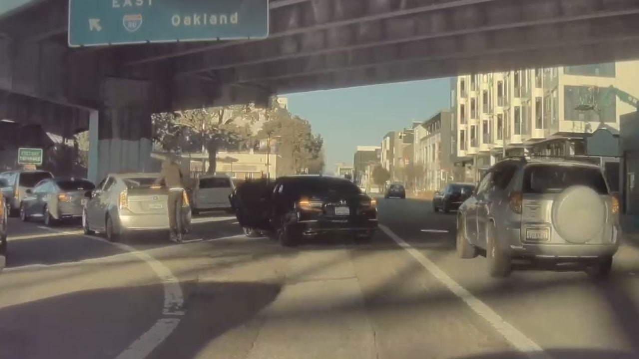 Dashcam video shows robber speed away after breaking driver's rear windshield, 2/7/21