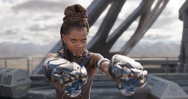 A screenshot featuring Suri, a character in Black Panther.