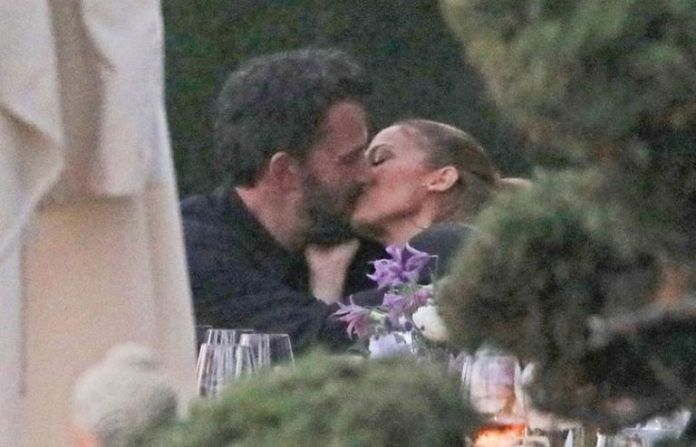 Jennifer Lopez and Ben Affleck kiss while having a meal with the Lopez family at a luxury restaurant in Malibu, west of Los Angeles, USA.