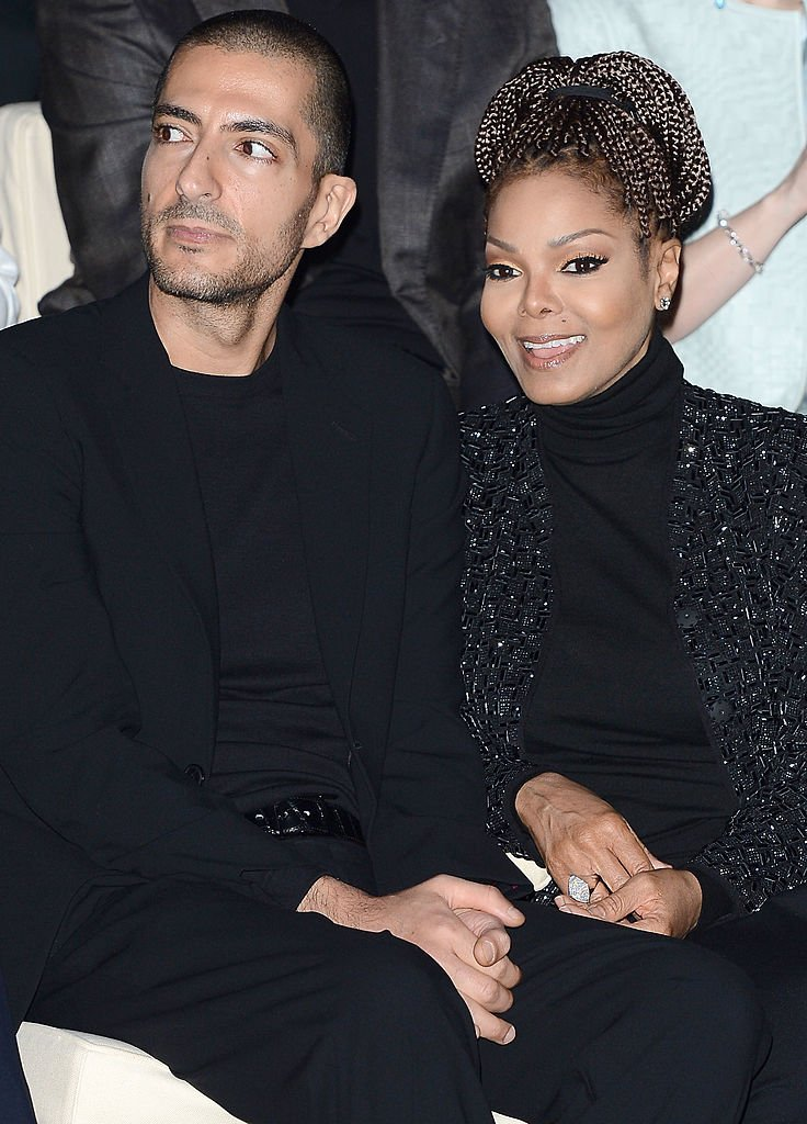 Wissam al Mana and Janet Jackson attend the Giorgio Armani Fashion Show during Fashion Week in February 2013 |  Photo: Getty Images