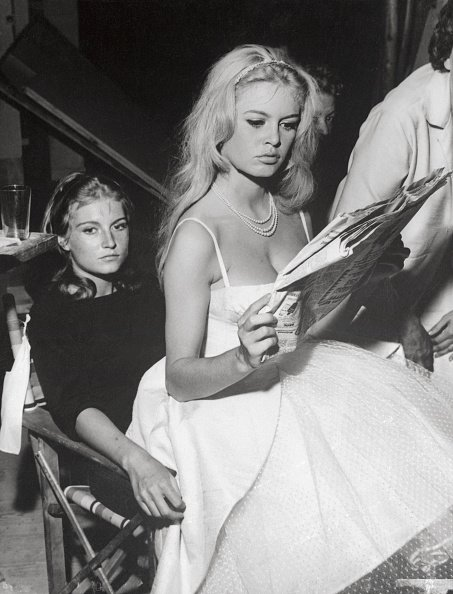 French star Brigitte Bardot relaxes on her sister Mikanou's lap.  |  Photo: Getty Images