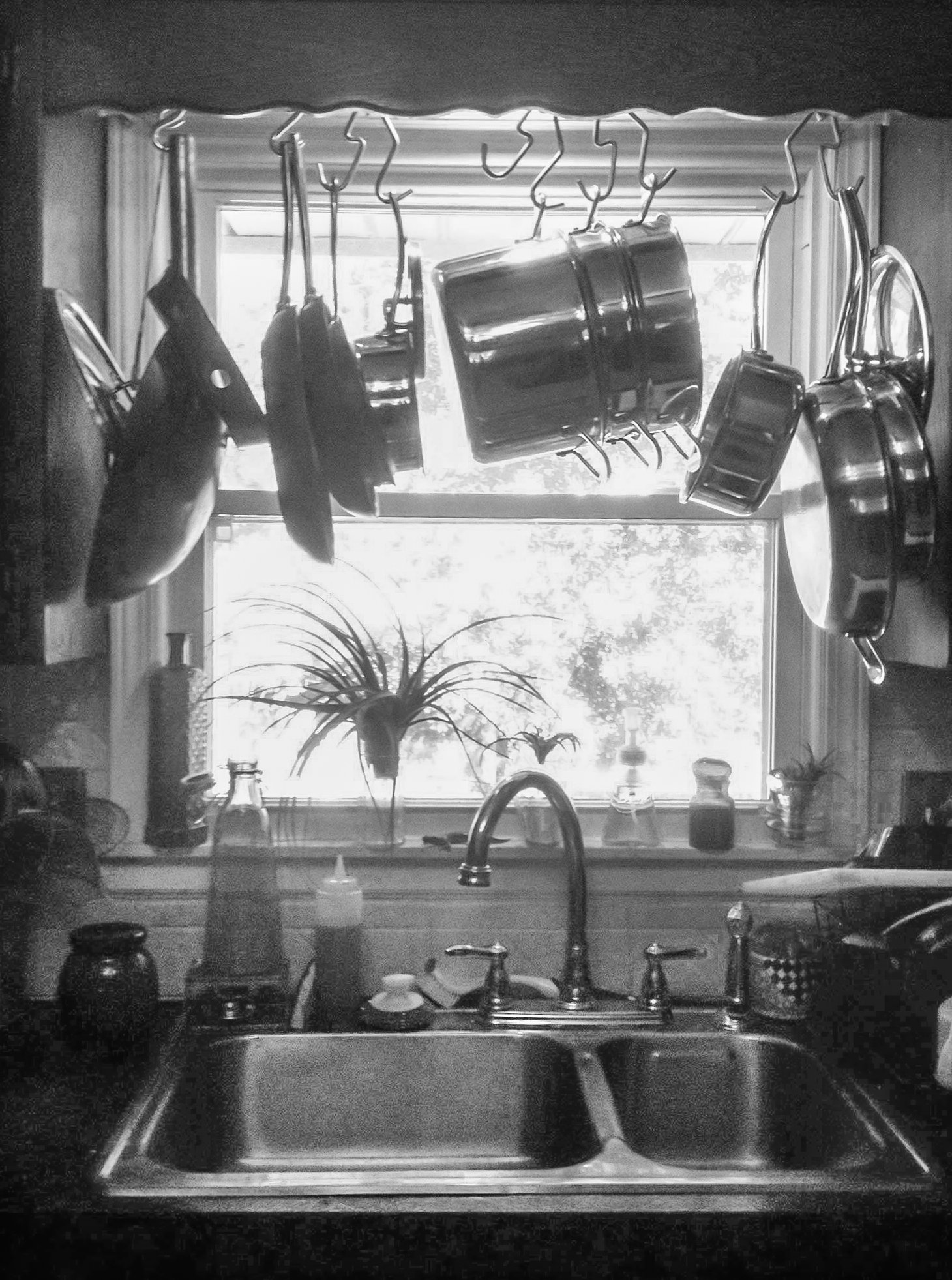 hang your pot rack over the sink and