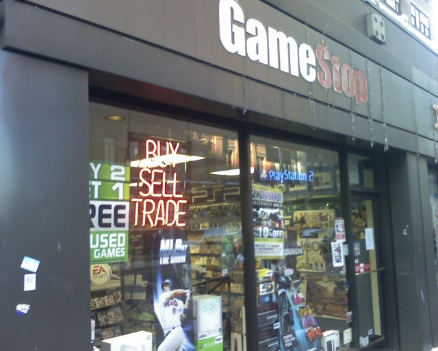 """Pretty much every part of that """"Buy Sell Trade"""" sign is suffering in GameStop's latest fiscal year."""