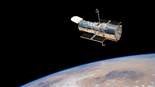 Hubble Space Telescope above Earth, photographed during STS-125, Servicing Mission 4, May 2009.