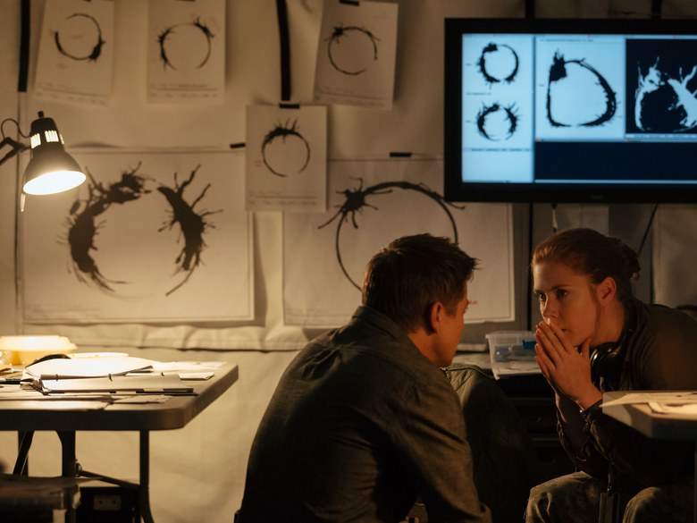 Louise and Ian are analyzing the alien language.