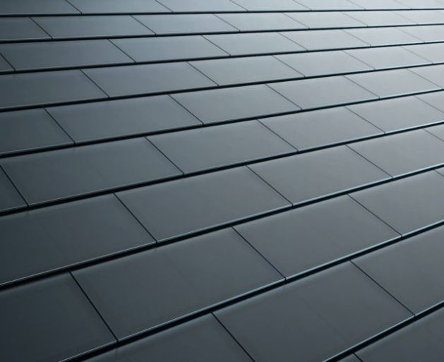 Tesla smooth black glass solar roof tiles.