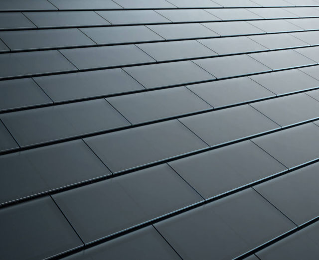Tesla smooth black glass solar roof tiles.