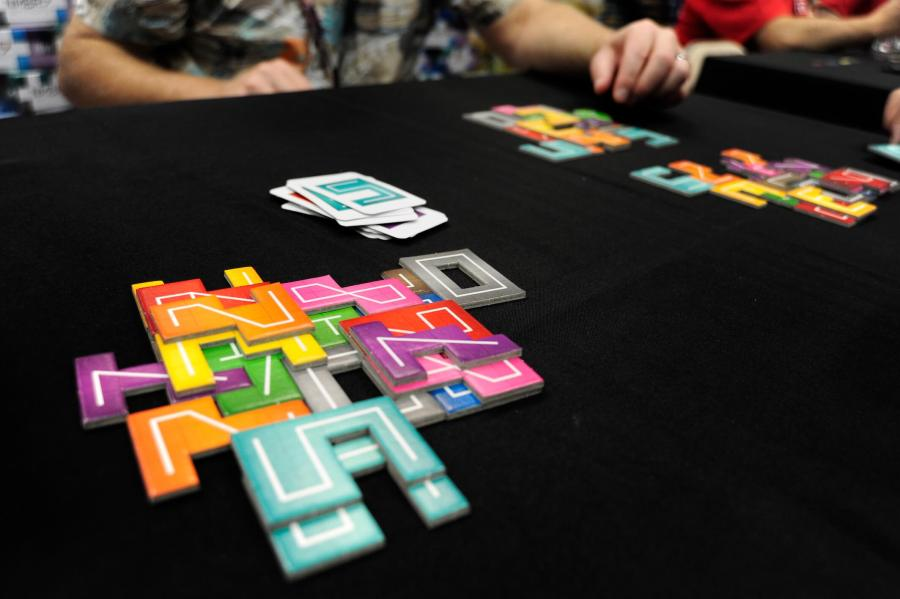 The hottest new board games from Gen Con 2017   Ars Technica NMBR 9 jumps on the current trend in board gaming of Tetris like spatial  puzzles   but this time  we re going up  In NMBR 9  players stack flat  number shaped