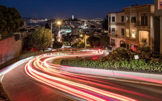 Lombard Street in San Francisco, with laser beams photoshopped onto the street.