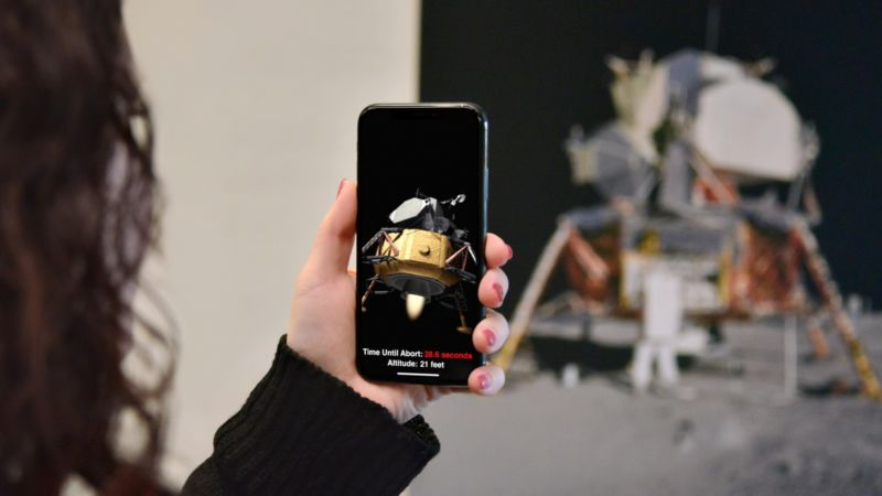 A Woman Uses A Smartphone To Take A Photo