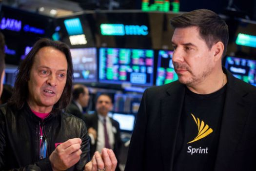 T-Mobile CEO John Legere and Sprint CEO Marcelo Claure speak during an interview.