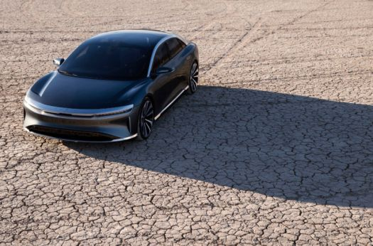 Electric car speeds across desert.
