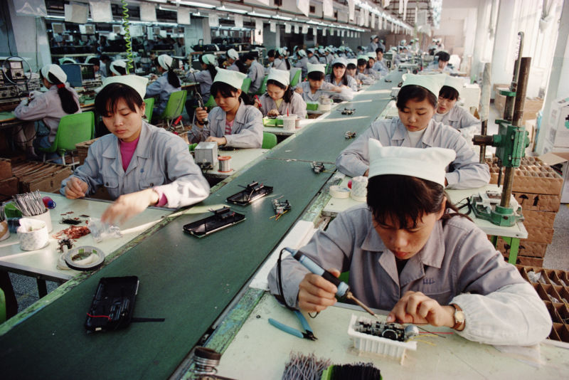 Women soldering components at a factory in Shenzhen, Guangdong Province, China.