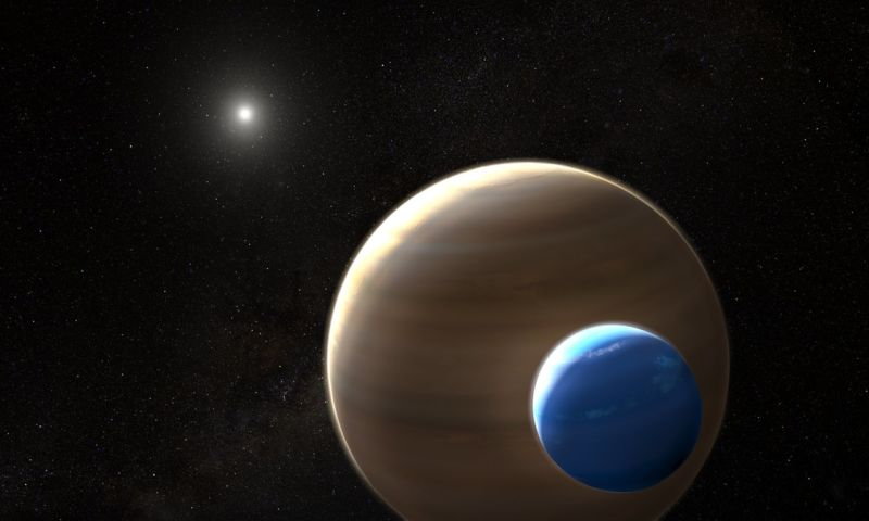 Image of a two massive bodies orbiting a star.