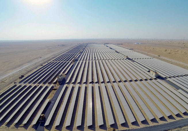 Solar panels in a row in the desert