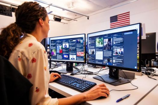 "War room leader for Brazil elections Lexi Sturdy works in Facebook's ""War Room,"" during a media demonstration on October 17, 2018, in Menlo Park, California."