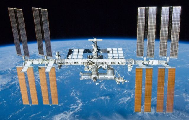The essentially complete International Space Station in 2010, as seen by space shuttle <em data-recalc-dims=