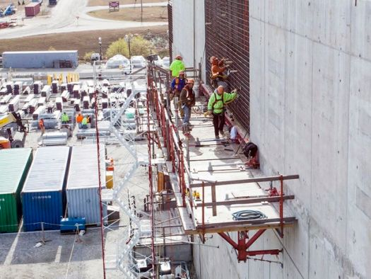 Workers on scaffolding at the MOX facility.