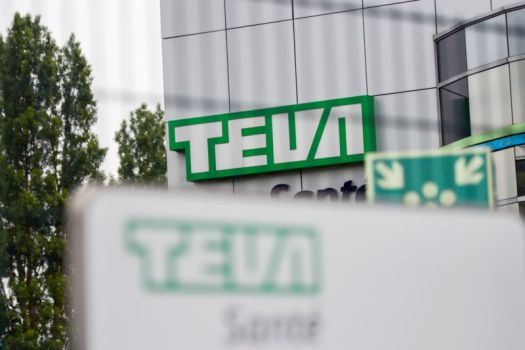 Exterior of a modern urban building with the word TEVA on it.