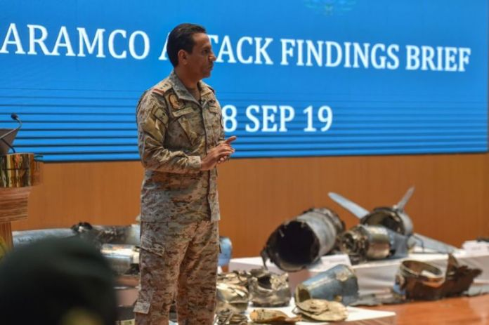 "Saudi defence ministry spokesman Colonel Turki bin Saleh al-Malki displays pieces of what he said were Iranian cruise missiles and drones recovered from the attack site that targeted Saudi Aramco's facilities, during a press conference in Riyadh on September 18, 2019.  US officials have now said that the US responded with a cyber attack against Iran's ""propaganda"" infrastructure."
