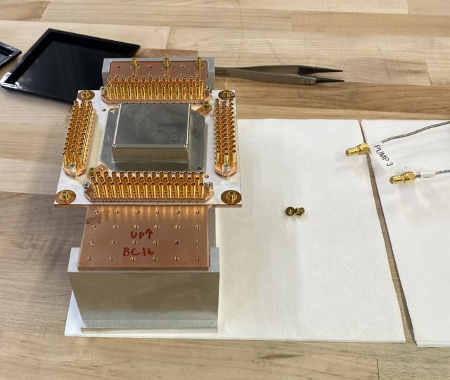 The chip's packaging is dominated by the wiring needed to feed signals in and out of the chip.