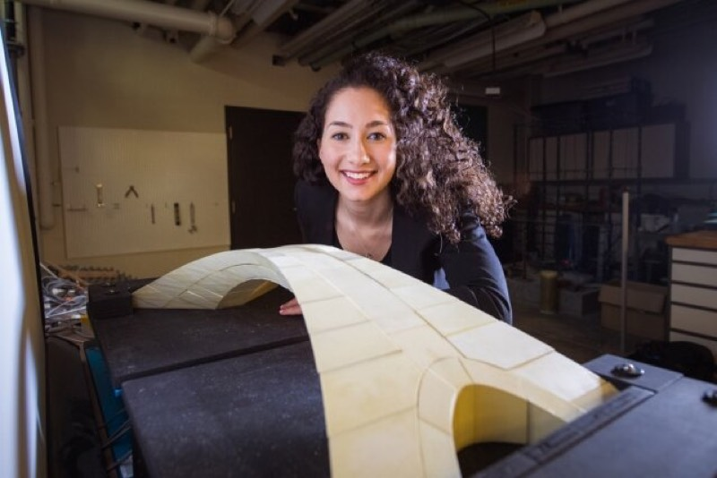 MIT graduate student Karly Bast with a model of Leonardo da Vinci's bridge.