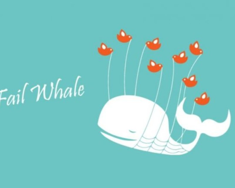 Cartoon image of a sperm whale being held aloft by balloons,