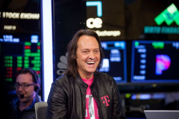 T-Mobile CEO John Legere smiling during an interview at the New York Stock Exchange.