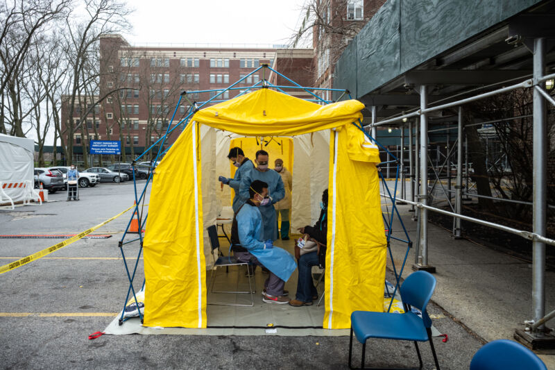 NEW YORK, NY - MARCH 20: Doctors test hospital staff with flu-like symptoms for COVID-19 at St. Barnabas hospital on March 20, 2020, in New York City. St. Barnabas hospital in the Bronx set-up tents to triage possible COVID-19 patients outside before they enter the main Emergency department area.