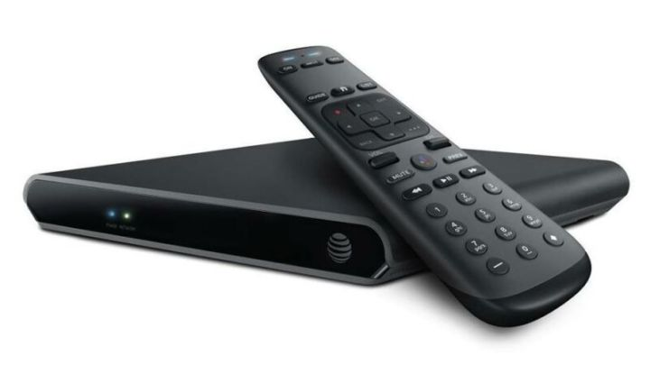 An AT&T streaming box for TVs and a TV remote control.