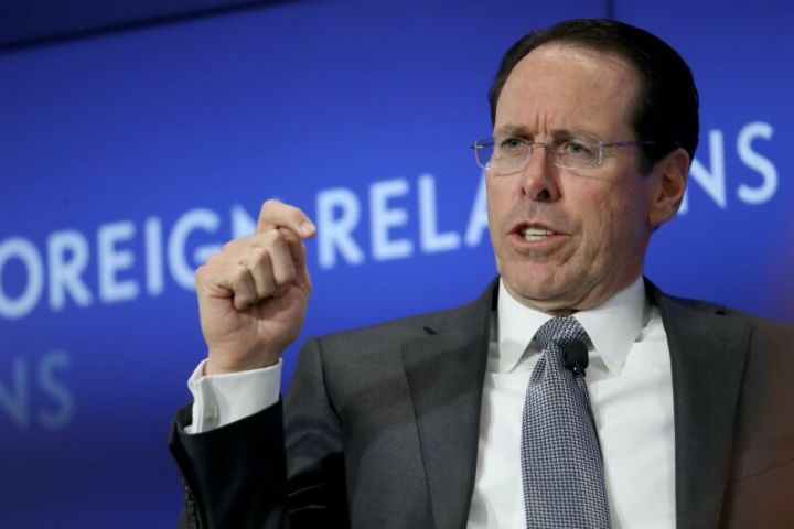 AT&T CEO Randall Stephenson gesturing with his hand and speaking at a conference.