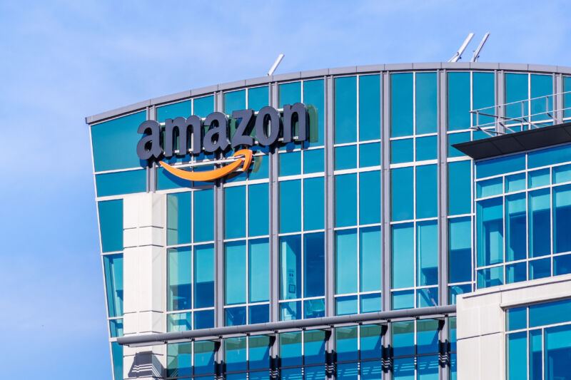 Multistory glass building with Amazon logo.