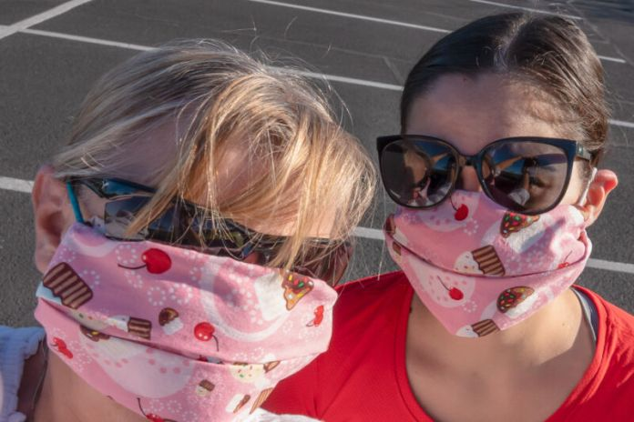 Two women in matching masks.