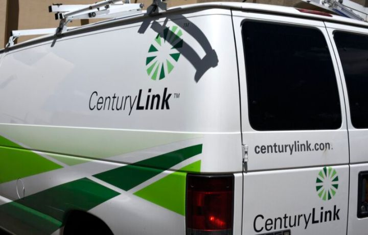 A CenturyLink service van seen from behind, with several CenturyLink logos visible.