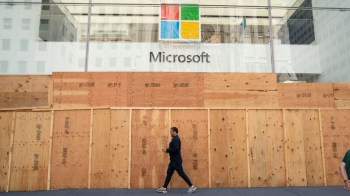"""Ironically, this boarded-up Microsoft Store location in New York City, seen on June 8, is one of the four in the world that <em>will</em> reopen—but as an """"experience center"""" where you can't buy anything."""