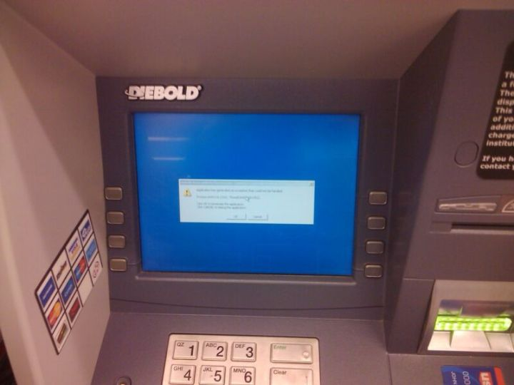 A warning appears on the screen of a Diebold ATM.