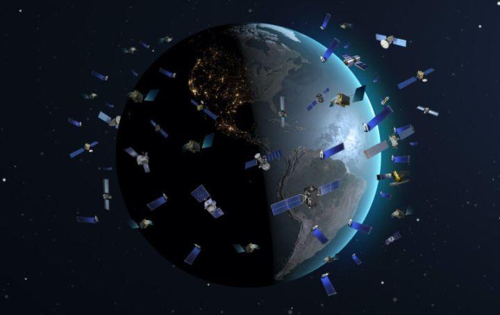 Illustration of many satellites orbiting the Earth.